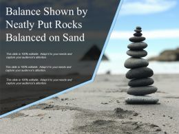 Balance Shown By Neatly Put Rocks Balanced On Sand