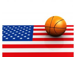 Basket Ball On American Flag Stock Photo