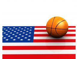 Basket Ball On American Flag Stock Photo
