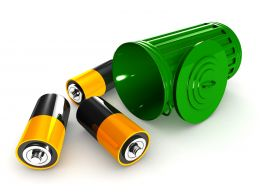Batteries In Green Recycle Bin Stock Photo