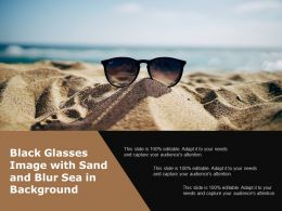 Black Glasses Image With Sand And Blur Sea In Background