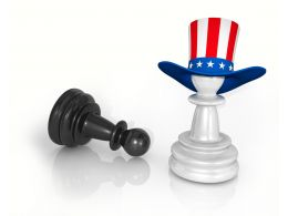 Black Pawn With White Pawn With Hat Of American Flag Stock Photo