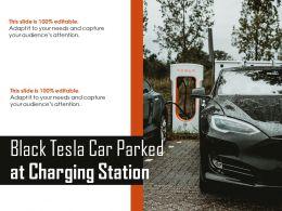 Black Tesla Car Parked At Charging Station