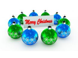 Blue And Green Decorative Balls With Merry Christmas Board Stock Photo
