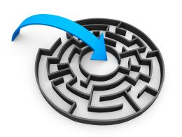 Blue Arrow Moving Towards Center Of Maze Depicting Path To Achievement Of Goals Stock Photo