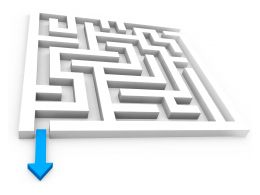 Blue Arrow To Show Solution Path From Maze Stock Photo