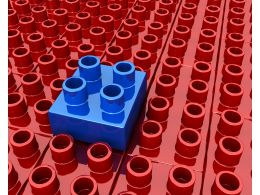 Blue Block As Leader Among Red Blocks Stock Photo