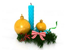 Blue Candle With Two Golden Decorative Balls With Bow And Green Grass Stock Photo