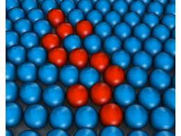 Blue Colored Metal Balls With Few Red Balls In Between Stock Photo