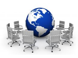 Blue Globe Surrounded By Chairs Showing Team Meeting Stock Photo
