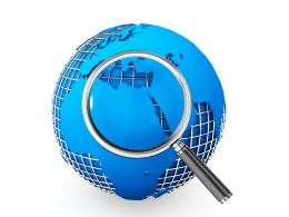Blue Globe With Magnifying Glass Focusing On Global Issues Stock Photo