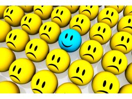 Blue Happy Face Among Yellow Unhappy Face Icons Stock Photo