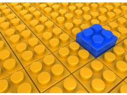 Blue Lego Block As Leader On Yellow Lego Block Background Stock Photo