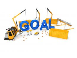 Blue Letters Of Goal With Construction Equipment Stock Photo