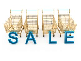 Blue Letters Of Sale With Four Shopping Carts Stock Photo