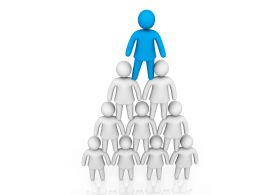 Blue Man Standing On White Men Pyramid Stock Photo