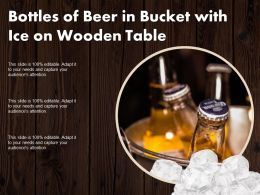 Bottles Of Beer In Bucket With Ice On Wooden Table