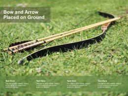 Bow And Arrow Placed On Ground