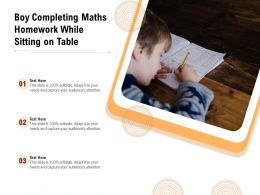 Boy Completing Maths Homework While Sitting On Table
