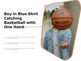 Boy In Blue Shirt Catching Basketball With One Hand