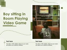 Boy Sitting In Room Playing Video Game