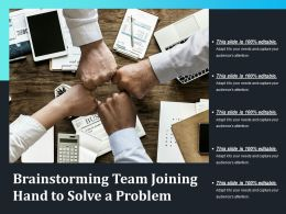 Brainstorming Team Joining Hand To Solve A Problem
