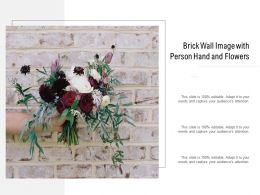 Brick Wall Image With Person Hand And Flowers