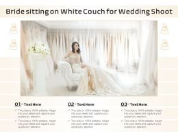 Bride Sitting On White Couch For Wedding Shoot