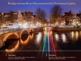 Bridge Across River Decorated With Christmas Lights