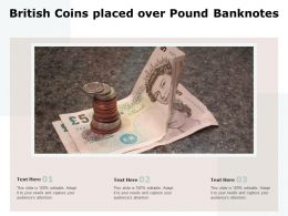 British Coins Placed Over Pound Banknotes