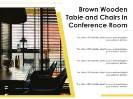 Brown Wooden Table And Chairs In Conference Room