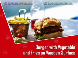 Burger With Vegetable And Fries On Wooden Surface