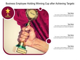 Business Employee Holding Winning Cup After Achieving Targets