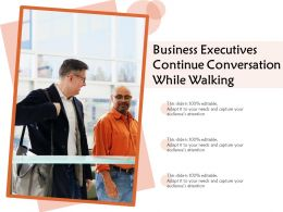 Business Executives Continue Conversation While Walking