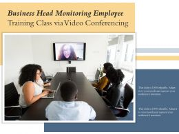Business Head Monitoring Employee Training Class Via Video Conferencing