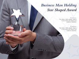 Business Man Holding Star Shaped Award