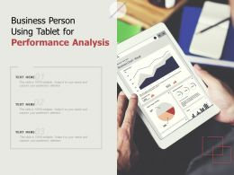Business Person Using Tablet For Performance Analysis