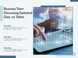 Business Team Discussing Statistical Data On Tablet