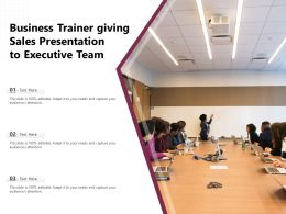 Business Trainer Giving Sales Presentation To Executive Team