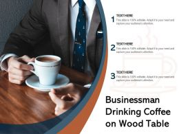 Businessman Drinking Coffee On Wood Table