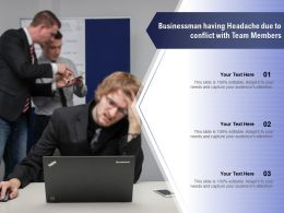Businessman Having Headache Due To Conflict With Team Members