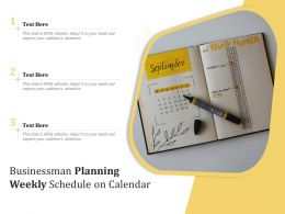 Businessman Planning Weekly Schedule On Calendar