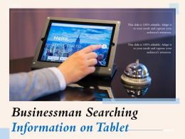 Businessman Searching Information On Tablet