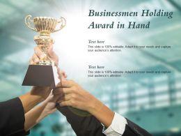 Businessmen Holding Award In Hand