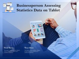 Businessperson Assessing Statistics Data On Tablet