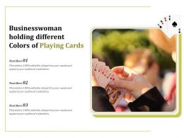 Businesswoman Holding Different Colors Of Playing Cards