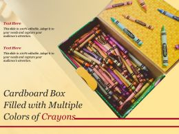 Cardboard Box Filled With Multiple Colors Of Crayons
