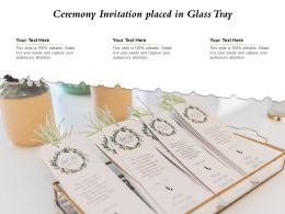 Ceremony Invitation Placed In Glass Tray