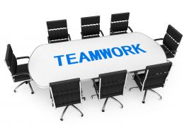 Chairs And Table For Team Meeting Along With Word Teamwork Stock Photo