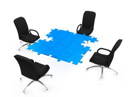 Chairs Around Puzzle Table Stock Photo